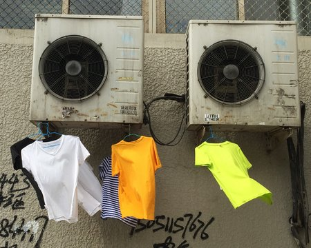 T-shirts On Hanger Hanging Against Air Duct