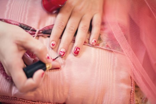 Close-up Of Painting Nails