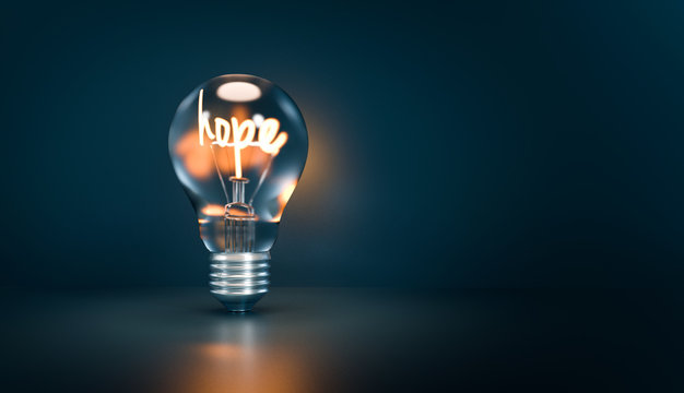 A metaphor about the Hope is the lightning from the desperation. Isolated Bulb on a darke background. 3D illustration.