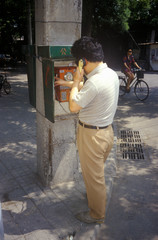 Poster Peking Chinese man making call at pay phone in Beijing in Hebei Province, People's Republic of China