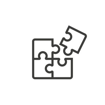 Puzzle pieces icon vector on white background