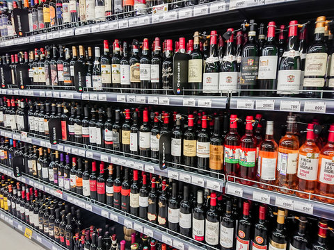 Saratov / Russia - February 5, 2019: Various brands of red and pink wine on the shelves of the supermarket.