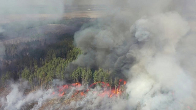 An aerial view shows a forest fire in the exclusion zone around the Chernobyl nuclear power plant