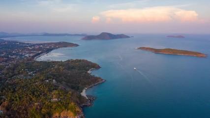 Fototapete - Aerial hyperlapse over the tropical coast of Phuket island during sunset, Thailand