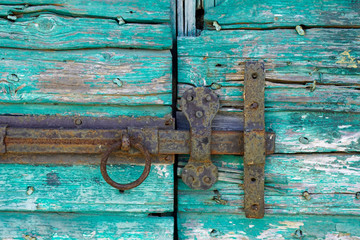 Rusty old Door bolt on an old door
