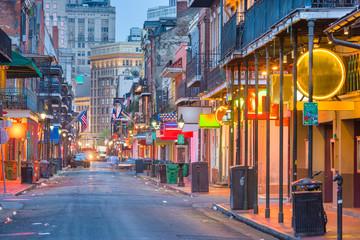 Fototapete - Bourbon St, New Orleans, Louisiana, USA cityscape of bars and restaurants at twilight.