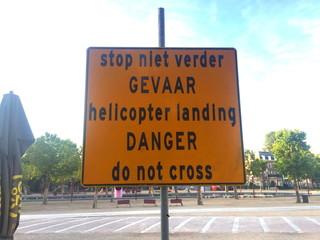 sign saying: danger! helicopter landing, do not cross!