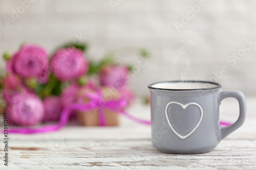 Mother's day concept. Cup of coffee or tea with heart, present and roses copy space.