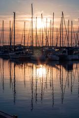 sailing boats at sunset in harbour
