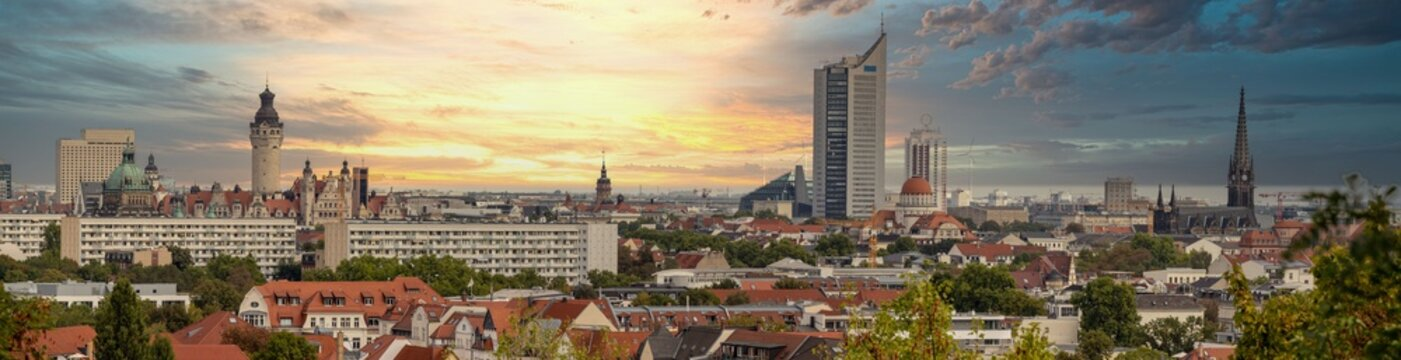 Panorama of the city of Leipzig, Saxony, with tall buildings, town hall and churches with an interesting colored sky