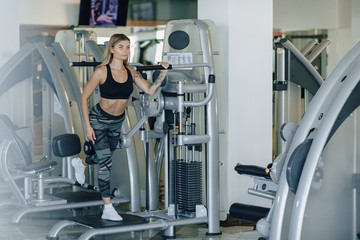Fototapeta attractive sports girl performs exercises on hips and buttocks. healthy lifestyle.