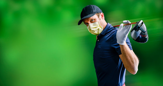 Golfer with protective mask and iron on his shoulders waiting for his turn to make his best shot, isolated on green background. COVID-19 alert