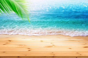 Wall Mural - Wooden desk with empty space for advertisement display and Sea beach soft ocean wave breaking on wood floor ,Summer background concept