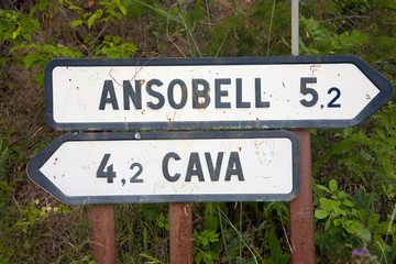 Wall Mural - Road signs to Ansobell and Cava Medieval villages in Pyrenees Mountains, near La Seu d'Urgell, Cataluna, province of Lleida, off N-260 Road, Spain, Europe