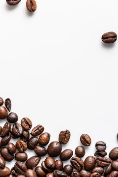 Rosted coffee beans on white background