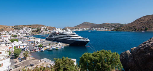Wall Mural - Skala village and cruise harbor in Patmos Island, Greece. Panoramic aerial landscape view.
