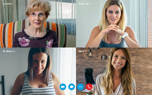 Group video call screen with four women