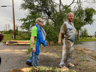 Jo and James Neely view the destruction of a tornado that hit the area on Easter Sunday afternoon in Soso,