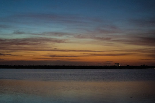 sunrise over lake, launch pad in background, cape canaveral