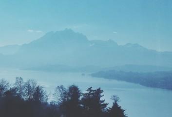 Aluminium Prints Scenic View Of Mountains In Fog