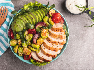 Fototapete - roasted sliced chicken fillet with brussels sprouts, tomatoes and herbs on a plate healthy food