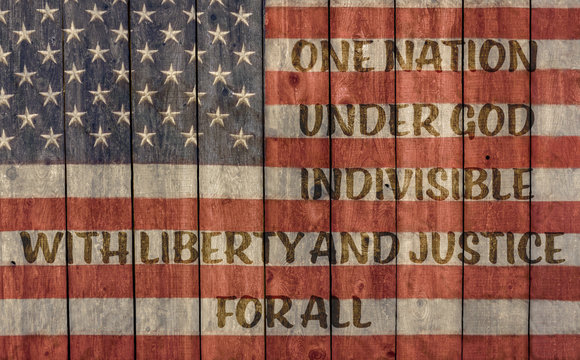 vintage american flag for which it stands, one nation under god indivisible with liberty and justice for all, painted on a weathered wood wall
