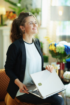 woman and closing laptop after successfully finish task