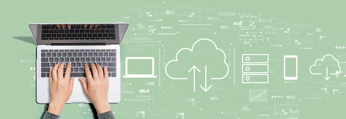 Cloud computing with person using a laptop computer Fotobehang
