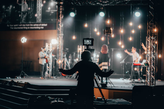Camera Operator worshipping with the praise band for online church
