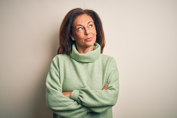 Wall Mural - Middle age beautiful woman wearing casual turtleneck sweater over isolated white background smiling looking to the side and staring away thinking.