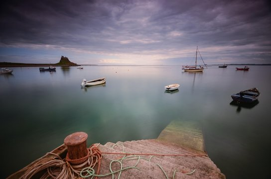 View Of Boats Moored In Calm Sea
