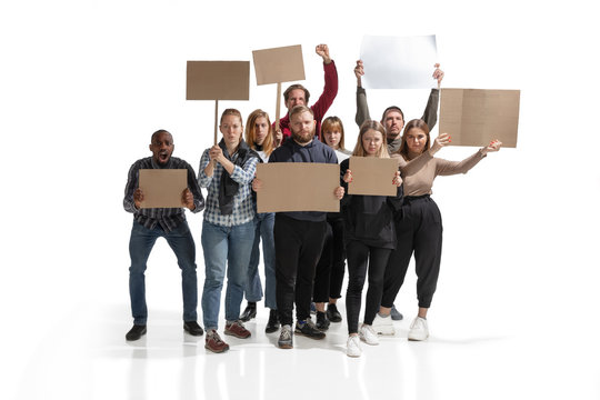 Emotional multicultural group of people screaming while holding blank placards on white background. Women and men shouting, calling. Activism, active citizenship, social life, protesting, human rights