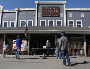Customers observe social distancing as they wait for their orders to be brought outside Idaho Lumber & Hardware