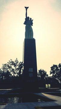Peace Statue At Nanjing Massacre Memorial Hall Against Sky