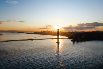 Aerial drone image of the Golden Gate bridge with an epic sunset behind it. Iconic landscape location.