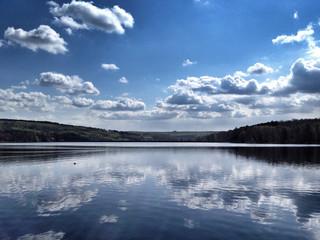 Fototapeta Cloudy Sky Reflected In Calm Lake