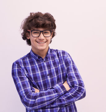 portrait  of smart looking arab teenager with glasses