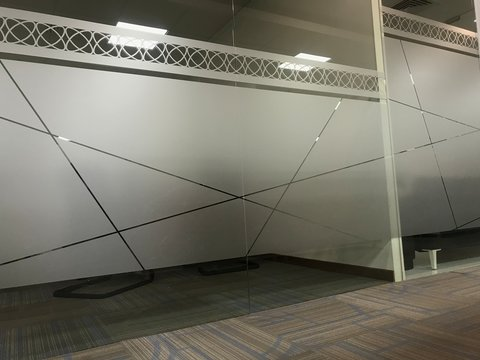 Images of Full height glass wall partitions for an office meeting room or manager room with an sticker of Frosted film for privacy of people for discussing in office interiors
