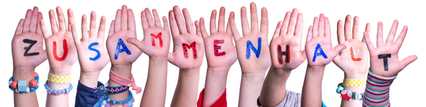 Kids Hands Holding Colorful German Word Zusammenhalt Means Togetherness. White Isolated Background