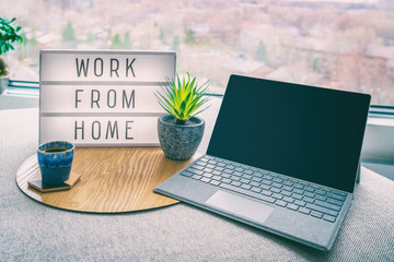 Working from home remote work inspirational social media lightbox message board next to laptop and...