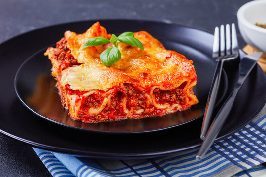 Stuffed pasta manicotti with bolognese on a plate