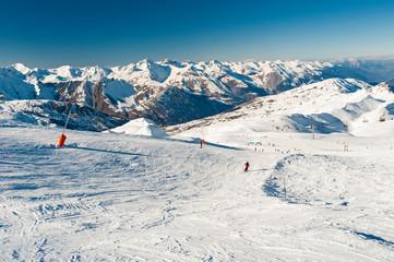 Wall Mural - View down a piste in alpine ski resort