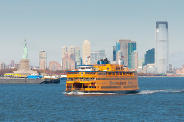 New York City, USA - November 18, 2011: Staten Island Ferry in New York Harbor with the Statue of Liberty in the background on November 18, 2011.
