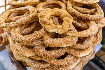 """koulouri"" traditional Greek crispy round bagels/ with sesame close up"
