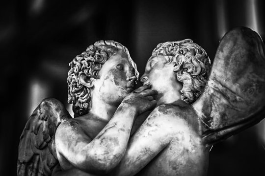 Close-up Of Angels Kissing Statue