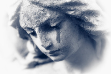 Fototapete - Death concept. Close Up of ancient stone statue of crying angel with tears in face as symbol of end of human life. Black and white image.