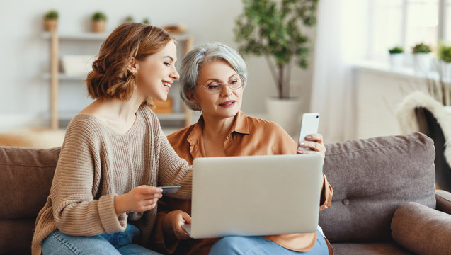 Young woman with mother shopping online at home.