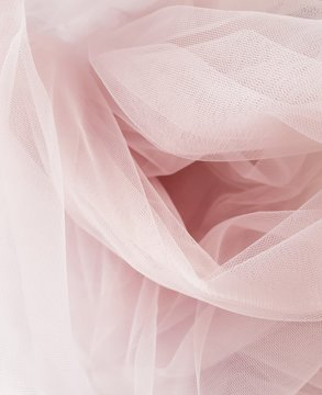 Abstract folded soft blush pink tulle background, Tulle texture, Tulle close up