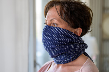 Hispanic woman wearing a blue face guard
