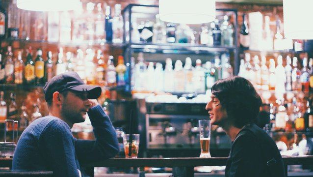 Male Friends Sitting At Bar